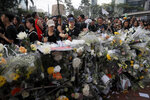 Mourners stop by a makeshift memorial, to lay flowers and pray for a man who fell to his death on Saturday after hanging a protest banner against an extradition bill in Hong Kong Sunday, June 16, 2019. Hong Kong residents were gathering Sunday for another mass protest over an unpopular extradition bill that has highlighted the territory's apprehension about relations with mainland China. (AP Photo/Kin Cheung)