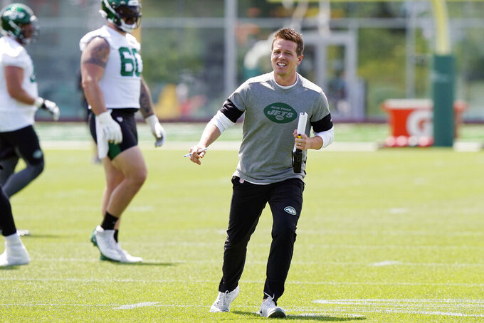 FILE - In this May 27, 2021, file photo, New York Jets offensive coordinator Mike LaFleur directs his players during an NFL football practice in Florham Park, N.J. LaFleur was still a teenager living at home when his big brother would bring his buddy over so they could raid the family's refrigerator and intercept the TV remote.  (AP Photo/Kathy Willens, File)