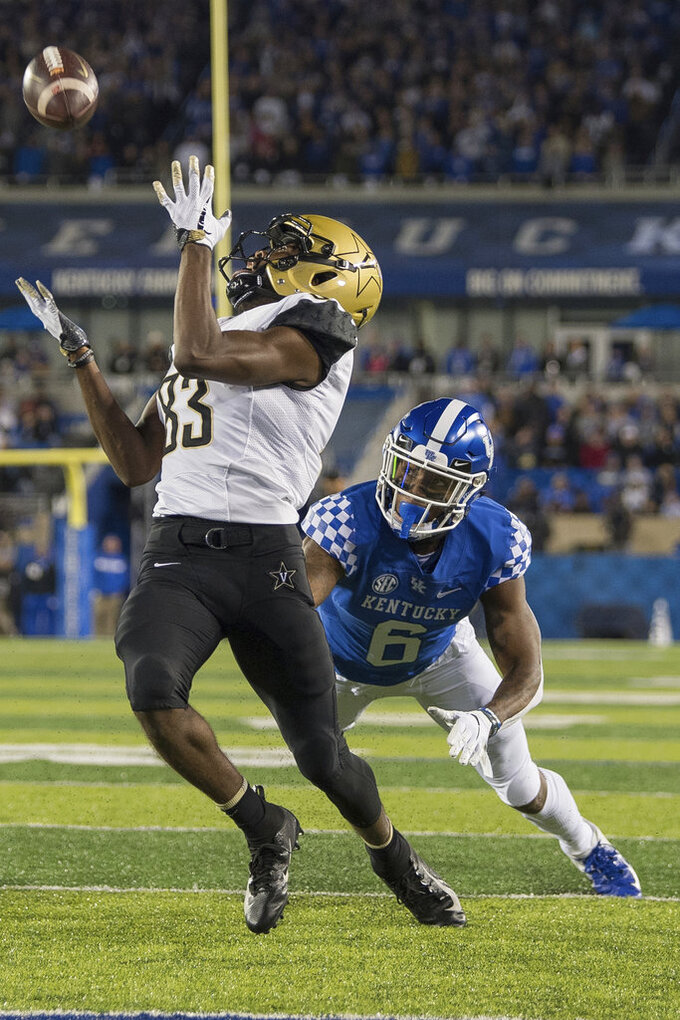 Vanderbilt wide receiver C.J. Bolar (83) catches a touchdown pass during the first half of an NCAA college football game against Kentucky in Lexington, Ky., Saturday, Oct. 20, 2018. (AP Photo/Bryan Woolston)