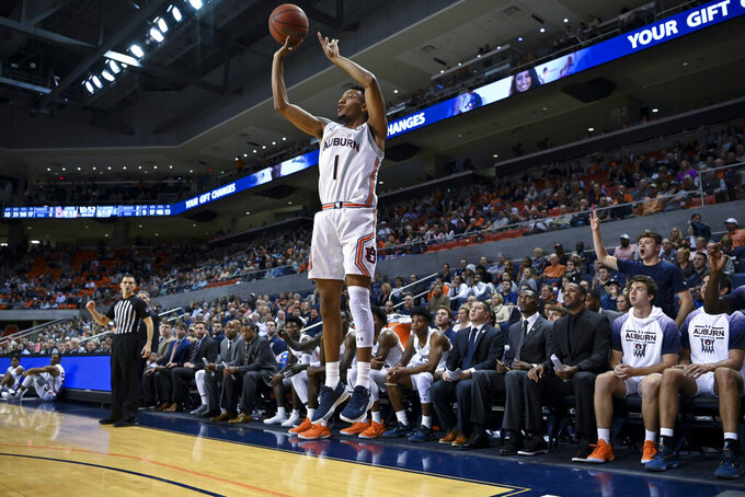 Auburn guard Jamal Johnson (1) shoots for three points against Georgia Southern during the second half of an NCAA college basketball game Tuesday, Nov. 5, 2019, in Auburn, Ala. (AP Photo/Julie Bennett)