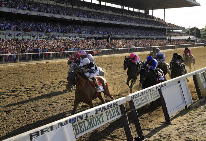 "FILE - In this June 8, 2019, file photo, Sir Winston (7), with jockey Joel Rosario up, crosses the finish line to win the 151st running of the Belmont Stakes horse race in Elmont, N.Y. New York will allow horse racing tracks and Watkins Glen International car track to reopen with the easing of the coronavirus outbreak. But Gov. Andrew Cuomo on Saturday, May 16, 2020, was quick to add a caveat: ""No crowds. No fans."" (AP Photo/Seth Wenig, File)"