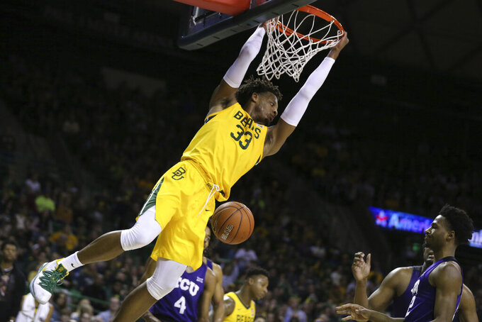 Baylor forward Freddie Gillespie dunks over TCU in the second half of an NCAA college basketball game, Saturday, Feb. 1, 2020, in Waco, Texas. Baylor won 68-52. (AP Photo/Rod Aydelotte)
