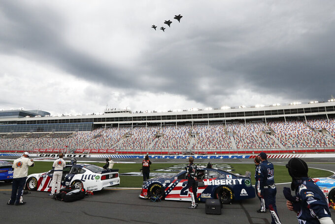 Military jets fly over Charlotte Motor Speedway before the start of the NASCAR Cup Series auto race Sunday, May 24, 2020, in Concord, N.C. (AP Photo/Gerry Broome)