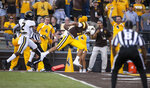 Wyoming quarterback Sean Chambers leaps for a touchdown past Missouri defender Demarkus Acy in the second quarter of an NCAA college football game, Saturday, Aug. 31, 2019. in Laramie, Wyo. (AP Photo/Michael Smith)