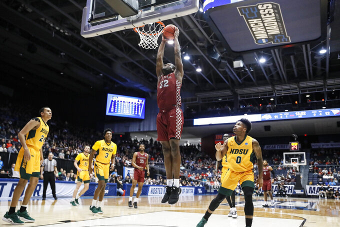 North Carolina Central's Raasean Davis (32) dunks as North Dakota State's Vinnie Shahid (0) watches during the first half of a First Four game of the NCAA men's college basketball tournament Wednesday, March 20, 2019, in Dayton, Ohio. (AP Photo/John Minchillo)