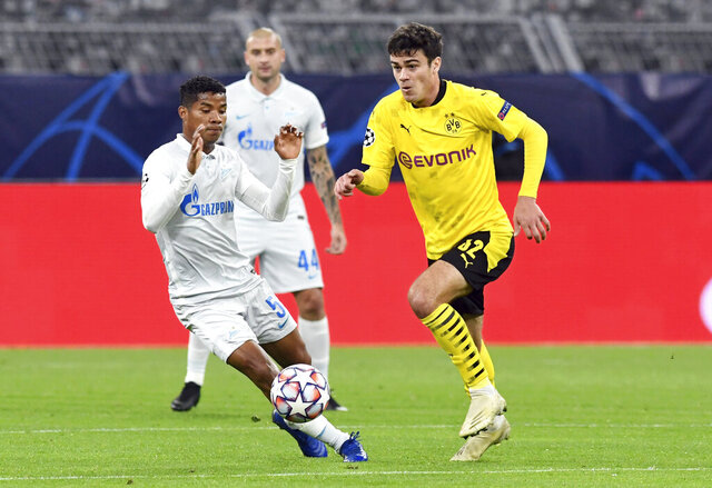 Dortmund's Giovanni Reyna, right, and Zenit's Wilmar Barrios, left, challenge for the ball during the Champions League group F soccer match between Borussia Dortmund and Zenit Saint Petersburg in Dortmund, Germany, Wednesday, Oct. 28, 2020. (Bernd Thissen/Pool via AP)