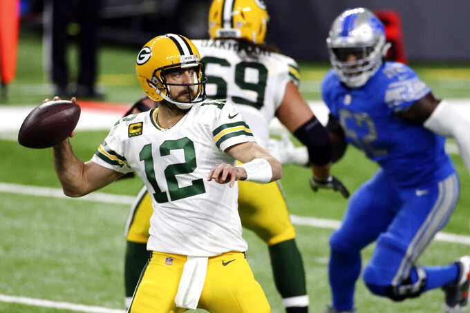 FILE - In this Dec. 13, 2020, file photo, Green Bay Packers quarterback Aaron Rodgers throws during the first half of an NFL football game against the Detroit Lions in Detroit. After a tumultuous offseason in which his future with the Packers appeared in doubt, reigning MVP Aaron Rodgers is ready to begin his 17th – and perhaps final – season in Green Bay. (AP Photo/Leon Halip, File)