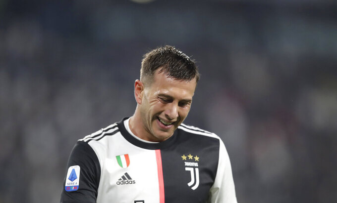 FILE - In this file photo dated Saturday, Oct.19, 2019,  Juventus' Federico Bernardeschi grimaces during a Serie A soccer match between Juventus and Bologna, at the Allianz stadium in Turin, Italy.  The weeks without playing has given Bernardeschi more time than ever to reflect on his responsibilities as a footballer, revealing Tuesday May 26, 2020, that family comes first as he reflects on sacrifices made by his family to enable him to attain his goals for Juventus and Italy. (AP Photo/Luca Bruno, FILE)