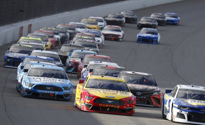 Chase Elliott (9) leads the field through the first turn at the NASCAR cup series auto race at Michigan International Speedway, Monday, June 10, 2019, in Brooklyn, Mich. (AP Photo/Carlos Osorio)