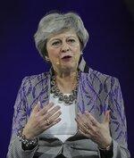 Former British Prime Minister Theresa May speaks at the Global Women's Forum in Dubai, United Arab Emirates, Monday, Feb. 17, 2020. (AP Photo/Kamran Jebreili)