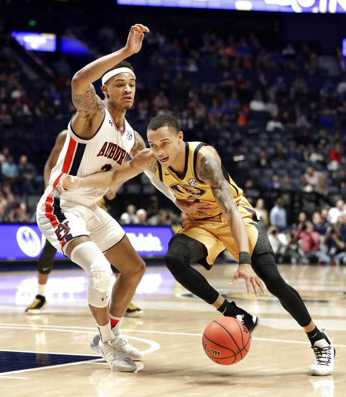 Missouri guard Xavier Pinson, right, drives against Auburn guard Bryce Brown, left, in the first half of an NCAA college basketball game at the Southeastern Conference tournament Thursday, March 14, 2019, in Nashville, Tenn. (AP Photo/Mark Humphrey)