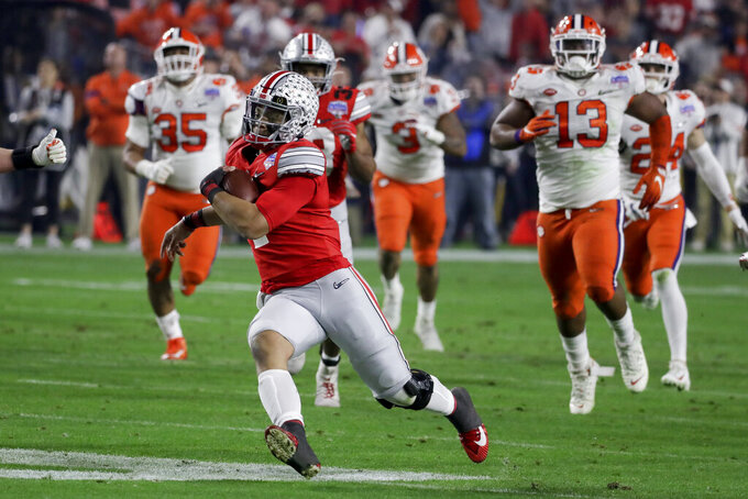 Ohio State quarterback Justin Fields carries the ball during the first half against Clemson in the Fiesta Bowl NCAA college football playoff semifinal Saturday, Dec. 28, 2019, in Glendale, Ariz. (AP Photo/Rick Scuteri)