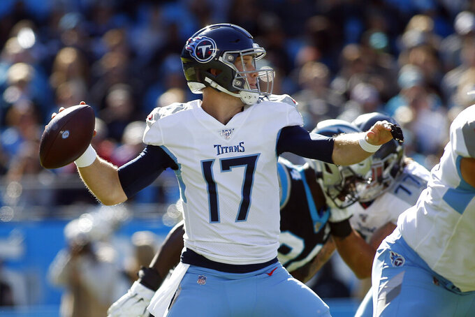 Tennessee Titans quarterback Ryan Tannehill (17) passes against the Carolina Panthers during the first half of an NFL football game in Charlotte, N.C., Sunday, Nov. 3, 2019. (AP Photo/Brian Blanco)