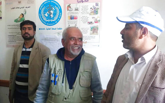 This undated photo provided by Ishaq Abdel-Wareth shows Dr. Yassin Abdel-Wareth, center, one of a handful of epidemiologists in Yemen who died of COVID-19 on June 16, 2020, in Sanaa, Yemen. His family said he may have contracted the virus while inspecting a quarantine facility set up outside the capital, Sanaa, by Houthi rebels, who had been concealing the virus's spread within Yemen.   (Ishaq Abdel-Wareth via AP)