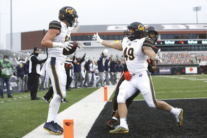 California tight end Jake Tonges (85) celebrates his touchdown with fulllback Drew Schlegel (49) during the second half of an NCAA college football game against Oregon State in Corvallis, Ore., Saturday, Nov. 21, 2020. Oregon State won 31-27. (AP Photo/Amanda Loman)