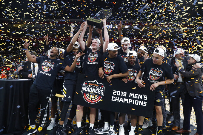 Northern Kentucky players celebrate their 77-66 win against Wright State after an NCAA college basketball game for the Horizon League men's tournament championship in Detroit, Tuesday, March 12, 2019. (AP Photo/Paul Sancya)