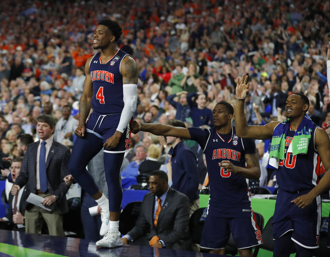 Auburn players react during the second half in the semifinals of the Final Four NCAA college basketball tournament against Virginia, Saturday, April 6, 2019, in Minneapolis. (AP Photo/Charlie Neibergall)