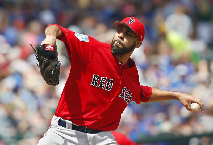 Boston Red Sox pitcher David Price pitches in the first inning of a spring training baseball game against the Chicago Cubs Tuesday, March 26, 2019, in Mesa, Ariz. (AP Photo/Sue Ogrocki)