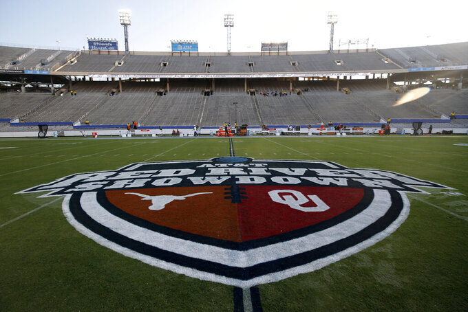 The Red River Showdown logo is shown on the field of the Cotton Bowl, prior to an NCAA college football game between the University of Texas and Oklahoma, in Dallas,  Saturday, Oct. 10, 2020. (AP Photo/Michael Ainsworth)