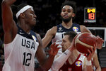 United States' Derrick White, top right looks on as United States' Myles Turner tries to block Poland's Mateusz Ponitka during a consolation playoff game for the FIBA Basketball World Cup at the Cadillac Arena in Beijing on Saturday, Sept. 14, 2019. U.S. defeated Poland 87-74 (AP Photo/Ng Han Guan)