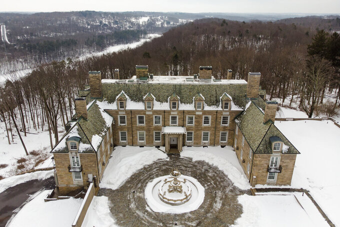 The Seven Springs, a property owned by former U.S. President Donald Trump, is covered in snow, Tuesday, Feb. 23, 2021, in Mount Kisco, N.Y. The estate, a 213-acre swath of nature surrounding a Georgian-style mansion, is a subject of two state investigations in New York: a criminal probe by Manhattan District Attorney Cyrus Vance Jr. and a civil inquiry by state Attorney General Letitia James. Both investigations focus on whether Trump manipulated the property's value to reap greater tax benefits from an environmental conservation arrangement he made while running for president in 2016. (AP Photo/John Minchillo)