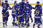 Buffalo Sabres teammates celebrate a victory over the New York Rangers following a shootout of an NHL hockey game, Saturday, April 3, 2021, in Buffalo, N.Y. (AP Photo/Jeffrey T. Barnes)