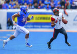 San Diego State wide receiver Fred Trevillion, right, turns up field after a reception as Boise State linebacker Curtis Weaver, left, gives chase in the first half of an NCAA college football game, Saturday, Oct. 6, 2018, in Boise, Idaho. (AP Photo/Steve Conner)