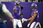 Minnesota Vikings wide receiver Stefon Diggs, left, celebrates with teammate Bisi Johnson, right, after catching a 51-yard touchdown pass during the first half of an NFL football game against the Philadelphia Eagles, Sunday, Oct. 13, 2019, in Minneapolis. (AP Photo/Bruce Kluckhohn)