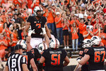 Oklahoma State quarterback Spencer Sanders (3) is lifted by teammates during touchdown celebrations in the end zone during the first half of an NCAA college football game against Kansas State, Saturday, Sept. 25, 2021, in Stillwater, Okla. (AP Photo/Brody Schmidt)