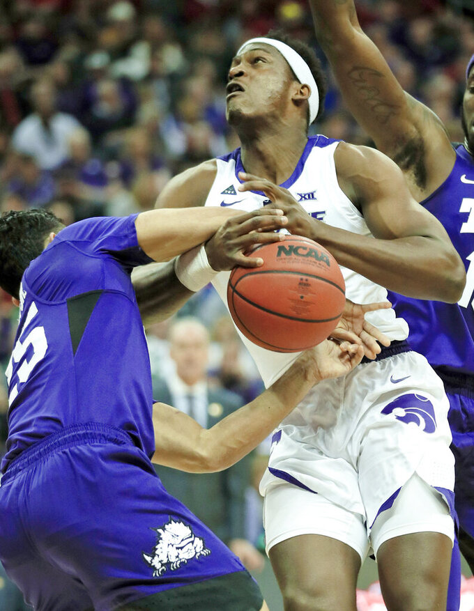 Kansas State forward Austin Trice, right, is fouled by TCU guard Alex Robinson (25) during the first half of an NCAA college basketball game in the quarterfinals of the Big 12 conference tournament in Kansas City, Mo., Thursday, March 14, 2019. (AP Photo/Orlin Wagner)