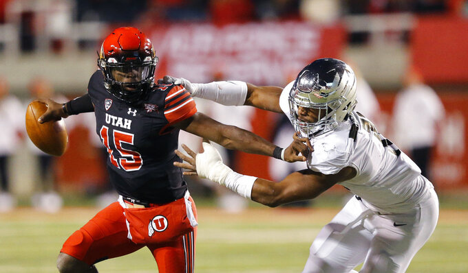 FILE - In this Saturday, Nov. 10, 2018, file photo, Utah quarterback Jason Shelley (15) stiff-arms Oregon linebacker Justin Hollins (11) in the second half during an NCAA college football game in Salt Lake City. One quality that teammates and coaches love about Shelley is his confidence. The moment is never too big for the redshirt freshman. (AP Photo/Rick Bowmer, File)