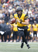 Appalachian State Mountaineers quarterback Zac Thomas looks for an open receiver during the first half of an NCAA college football game against the Louisiana Monroe Warhawks Saturday, Oct. 19, 2019, in Boone, NC. (AP Photo/Brian Blanco)