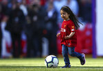 Makka, age 5, the daughter of Liverpool's Mohamed Salah, not pictured, kicks the ball at the end of the English Premier League soccer match between Liverpool and Wolverhampton Wanderers at the Anfield stadium in Liverpool, England, Sunday, May 12, 2019. Despite a 2-0 win over Wolverhampton Wanderers, Liverpool missed out on becoming English champion for the first time since 1990 because title rival Manchester City beat Brighton 4-1. (AP Photo/Dave Thompson)