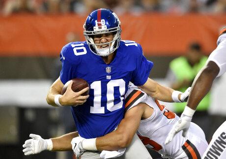 Joe Schobert, Eli Manning