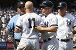 New York Yankees' Brett Gardner (11) argues with third base umpire Todd Tichenor after being ejected during the sixth inning of a baseball game against the Cleveland Indians, Saturday, Aug. 17, 2019, in New York. (AP Photo/Mary Altaffer)