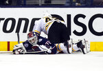 Boston Bruins forward David Backes, top, pushes Columbus Blue Jackets goalie Sergei Bobrovsky, of Russia, out of the goal during the second period of Game 4 of an NHL hockey second-round playoff series in Columbus, Ohio, Thursday, May 2, 2019. (AP Photo/Paul Vernon)
