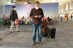 In this Feb. 1, 2020, photo provided by Ian Lipkin, Lipkin, director of the Center for Infection and Immunity at Columbia University, waits for his flight to Beijing at the Guangzhou airport in Guangzhou, China. In Beijing he met with members of the main China CDC along with other Chinese scientific leaders. Lipkin is under a quarantine since his return from China, monitoring for possible symptoms of coronavirus. (Guo Cheng/Courtesy of Ian Lipkin via AP)
