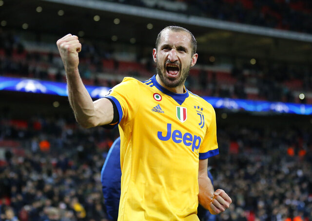 FILE - In this  Wednesday, March 7, 2018 filer, Juventus' Giorgio Chiellini celebrates at the end of a the Champions League, round of 16, second-leg soccer match between Juventus and Tottenham Hotspur, at the Wembley Stadium in London. The Juventus captain -- who has a master's degree in business administration -- was the main go-between for millionaire teammates like Cristiano Ronaldo and management when the squad agreed to forgo 90 million euros ($100 million) in wages to help the club during the coronavirus crisis. (AP Photo/Frank Augstein, File)