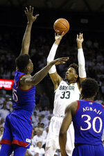 Baylor forward Freddie Gillespie, right, shoots over Kansas center Udoka Azubuike, left, during the second half of an NCAA college basketball game on Saturday, Feb. 22, 2020, in Waco, Texas. (AP Photo/Ray Carlin)