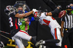 Tampa Bay Buccaneers cornerback Carlton Davis (24) breaks up a pass intended for Atlanta Falcons wide receiver Russell Gage (83) during the first half of an NFL football game, Sunday, Dec. 20, 2020, in Atlanta. (AP Photo/Danny Karnik)