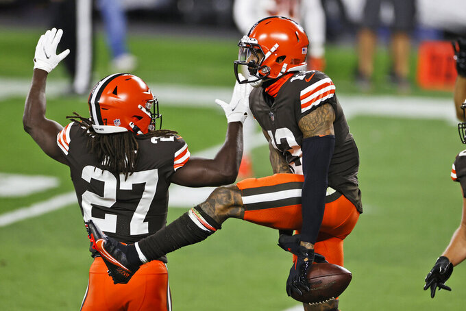 Cleveland Browns wide receiver Odell Beckham Jr., right, celebrates with running back Kareem Hunt after Beckham's touchdown during the first half of the team's NFL football game against the Cincinnati Bengals, Thursday, Sept. 17, 2020, in Cleveland. (AP Photo/Ron Schwane)