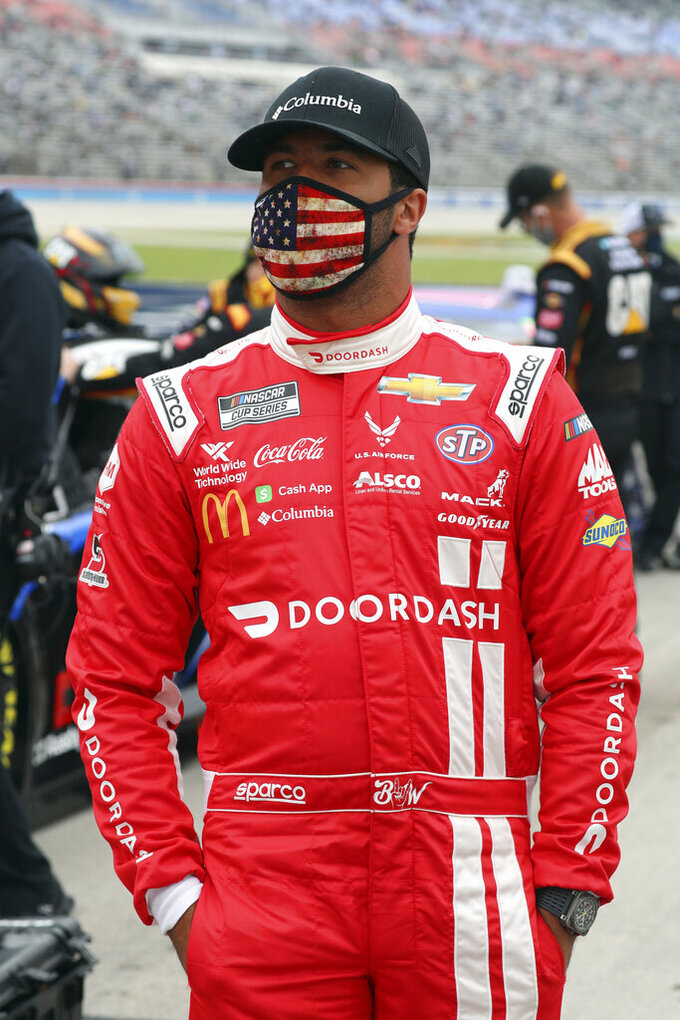 Bubba Wallace (43) waits on the grid before a NASCAR Cup Series auto race at Texas Motor Speedway in Fort Worth, Texas, Sunday, Oct. 25, 2020. (AP Photo/Richard W. Rodriguez)