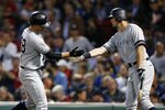 New York Yankees' Austin Romine, left, celebrates his solo home run with DJ LeMahieu during the fifth inning of a baseball game against the Boston Red Sox in Boston, Monday, Sept. 9, 2019. (AP Photo/Michael Dwyer)