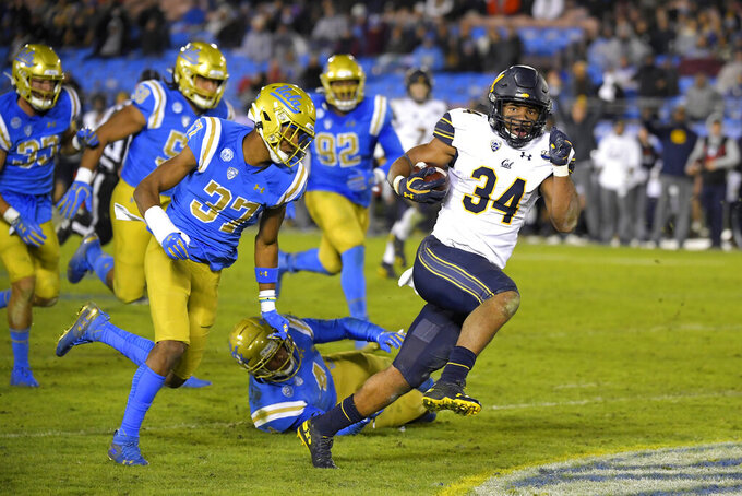 California running back Christopher Brown Jr., right, runs the ball as UCLA defensive back Quentin Lake (37) gives chase along with several other UCLA players during the second half of an NCAA college football game Saturday, Nov. 30, 2019, in Pasadena, Calif. California won 28-18. (AP Photo/Mark J. Terrill)