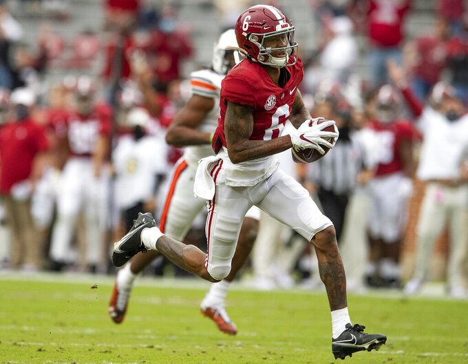 Alabama wide receiver DeVonta Smith (6) runs with a reception for a touchdown against Auburn during an NCAA college football game Saturday, Nov. 28, 2020, in Tuscaloosa, Ala. (Mickey Welsh/The Montgomery Advertiser via AP)