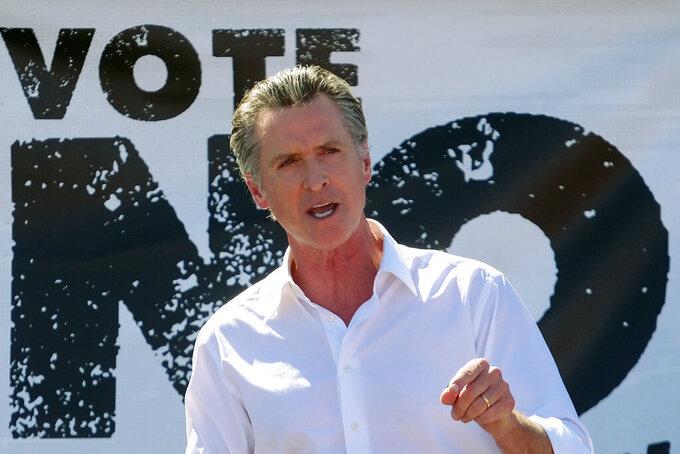 California Gov. Gavin Newsom speaks at a rally against the California gubernatorial recall election on Sunday, Sept. 12, 2021, in Sun Valley, Calif. (AP Photo/Ringo H.W. Chiu)