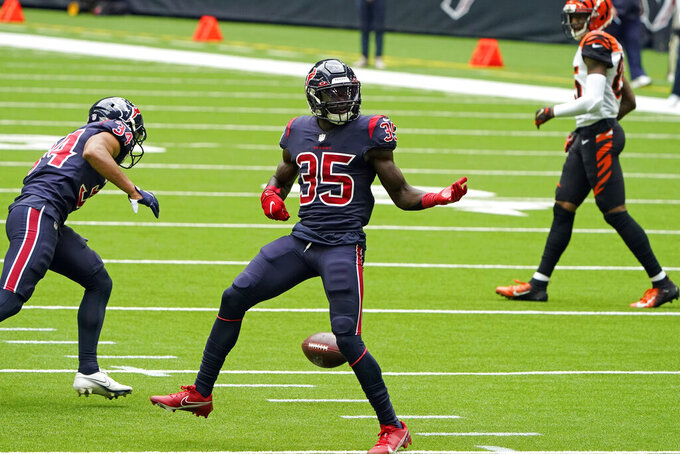 Houston Texans cornerback Keion Crossen (35) celebrates after breaking up a pass during the first half of an NFL football game against the Cincinnati Bengals Sunday, Dec. 27, 2020, in Houston. (AP Photo/Eric Christian Smith)