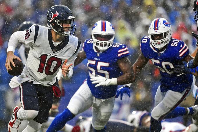 Houston Texans quarterback Davis Mills (10) scrambles through rain during the first half of an NFL football game against the Buffalo Bills, Sunday, Oct. 3, 2021, in Orchard Park, N.Y. (AP Photo/Adrian Kraus)