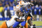 Kentucky quarterback Lynn Bowden Jr. (1) is tackled by Tennessee linebacker Quavaris Crouch (27) and defensive lineman Matthew Butler (94) during the first half of an NCAA college football game, Saturday, Nov. 9, 2019, in Lexington, Ky. (AP Photo/Bryan Woolston)