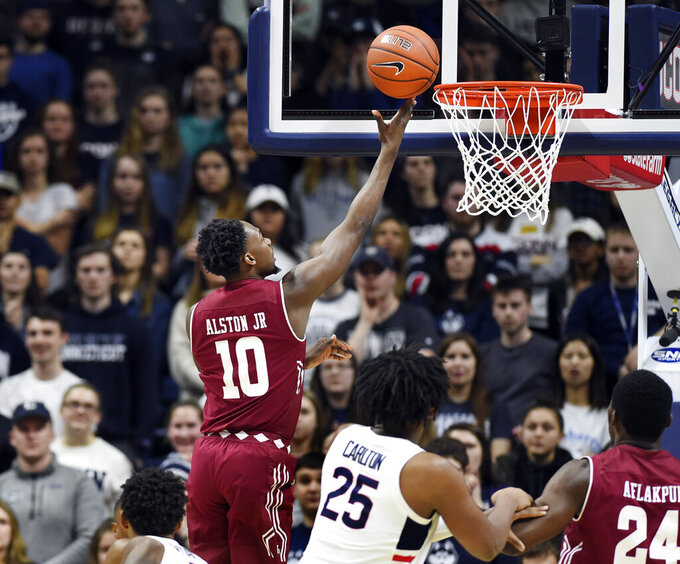 Temple's Shizz Alston Jr. (10) goes up for two of his game-high 34 points in the second half of an NCAA college basketball game against Connecticut, Thursday, March 7, 2019, in Storrs, Conn. (AP Photo/Stephen Dunn)